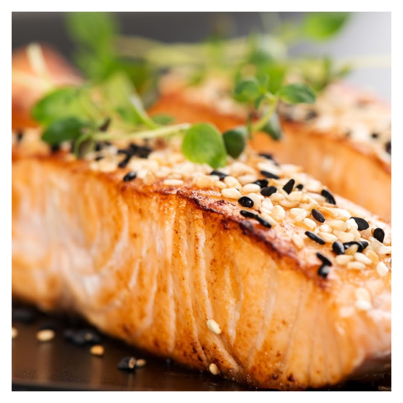 piece of salmon with seeds on top