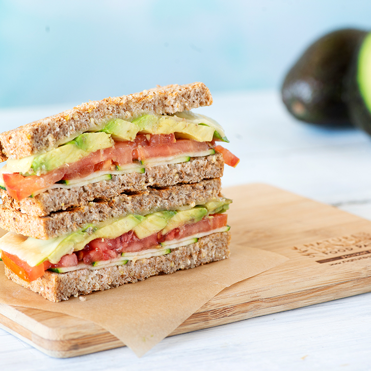 Avocado and tomato sandwich on a Nature's Food Patch wooden kitchen board