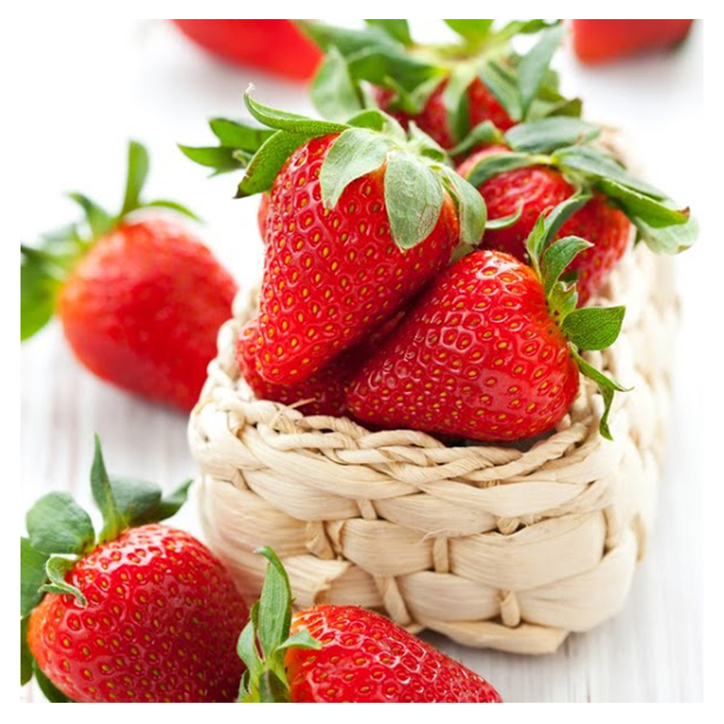 Fresh strawberries in and around woven basket
