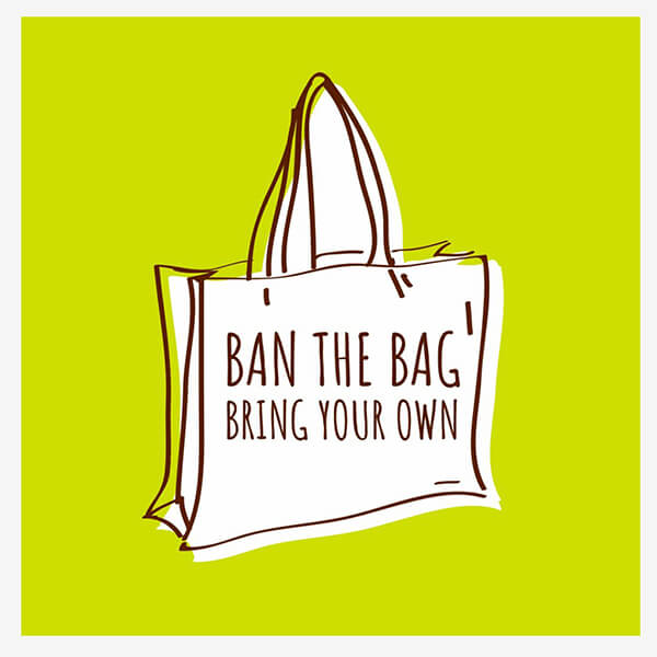 a white bag with written on it 'BAN THE BAG BRING YOUR OWN' on a green background